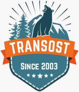 Transost Logo - Bär vor Bergen und Tannen, darunter Schriftzu Transost since 2003